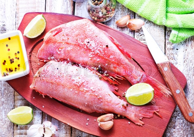 Stock image of 'raw ocean perch with salt and spice'