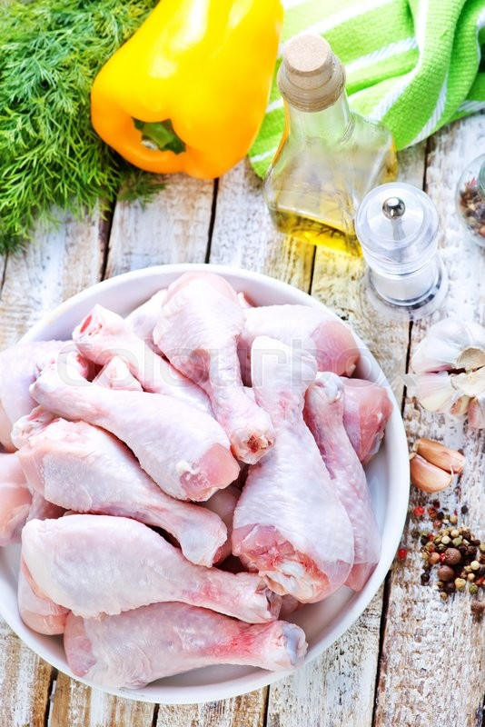 Stock image of 'raw chicken legs with salt and spice'