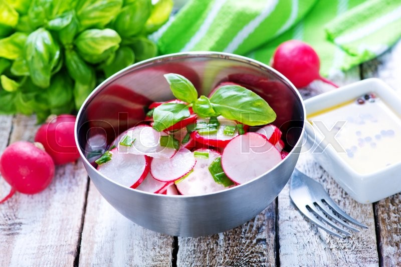 Stock image of 'salad with radish in the metal bowl'