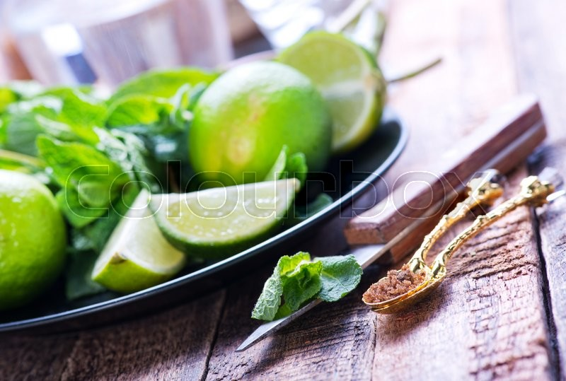 Stock image of 'lime,sugar and fresh mint on a table'