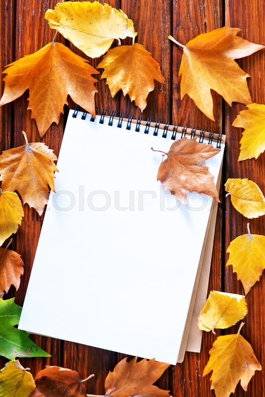 Stock image of 'autumn background, yellow leaves on a table'
