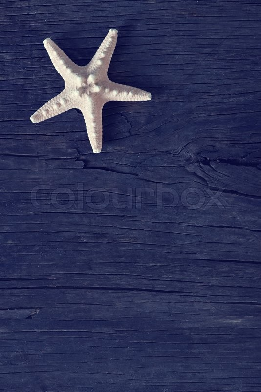 Stock image of 'starfish on wooden background, sea shell on a table'