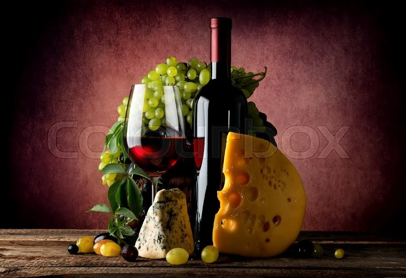 Stock image of 'Cheese and wine with grape on vinous background'