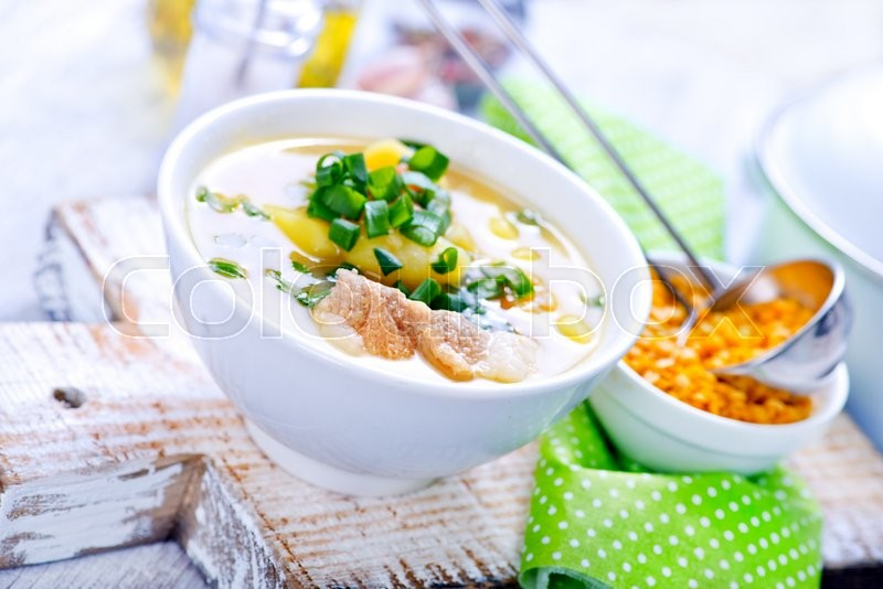 Stock image of 'lentil soup in bowl and on a table'