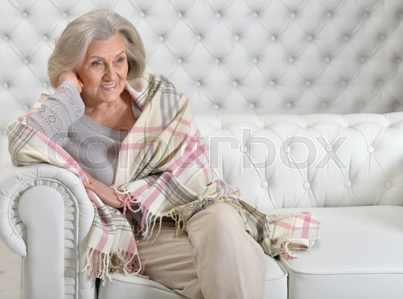 Stock image of 'Portrait of a happy senior woman resting at home'