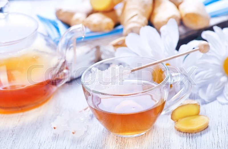 Stock image of 'ginger tea with fresh ginger on a table'