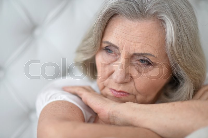 Stock image of 'Portrait of a melancholy senior woman close up'