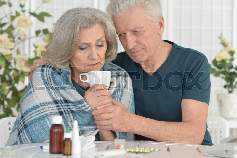Stock image of 'Portrait of a ill senior woman with caring husband'