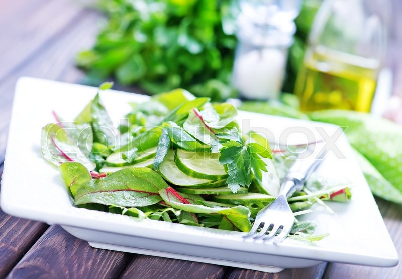 Stock image of 'fresh salad with latuk and mangld on plate'