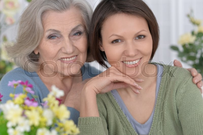 Stock image of 'cheerful senior mother and adult daughter together'