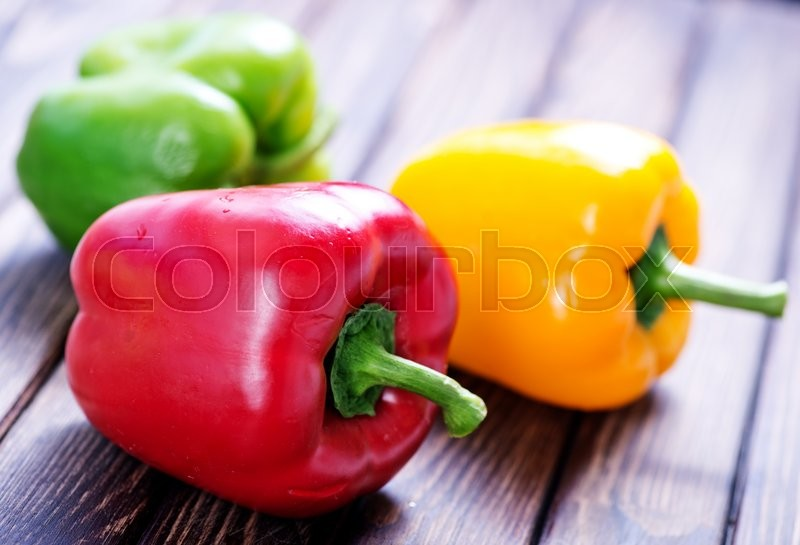 Stock image of 'color sweet pepper on the wooden table'