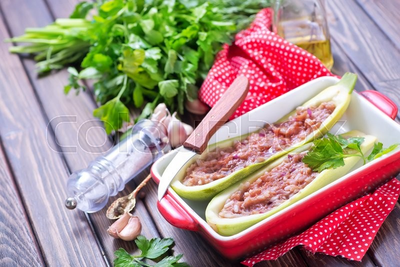Stock image of 'marrow stuffed with minced meat and rice'