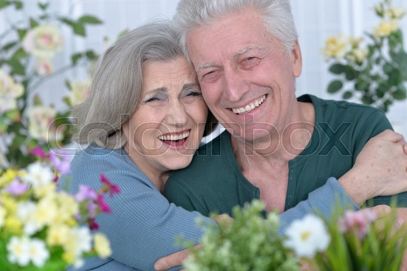 Stock image of 'Portrait of a happy senior couple close up'