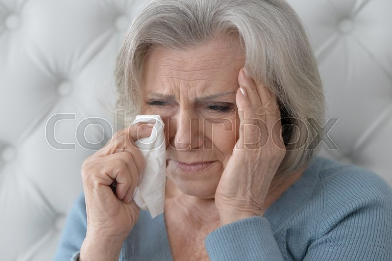 Stock image of 'Portrait of a crying senior woman close up'