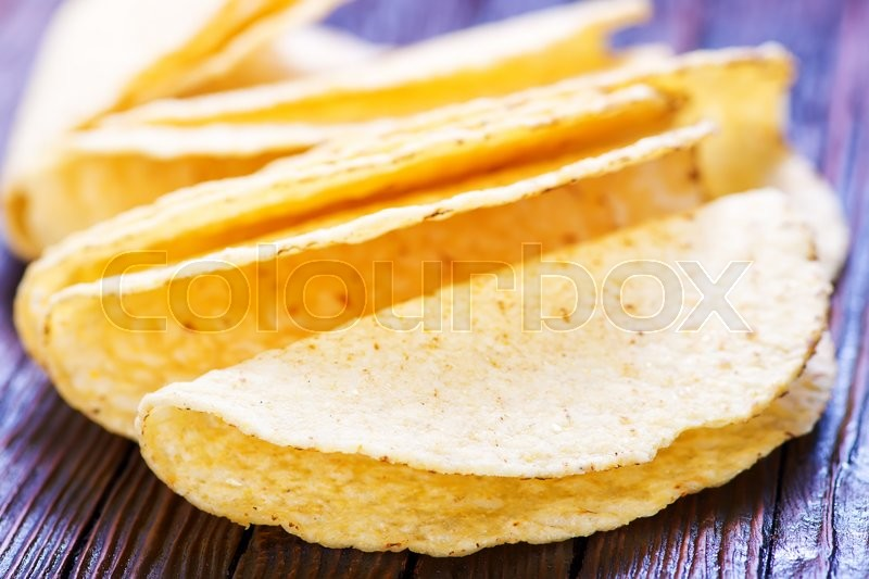 Stock image of 'taco shells on the wooden table, mexikan taco shells'