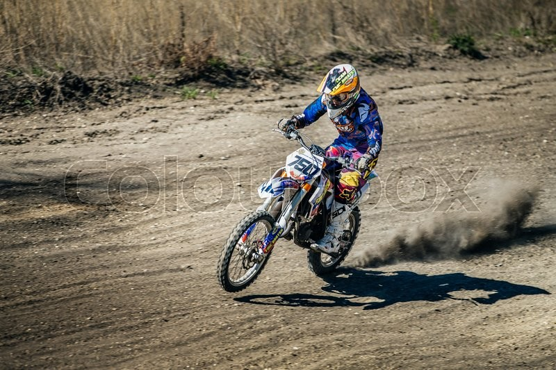 Editorial image of 'Miasskoe, Russia - May 02, 2016: racer on a motorcycle rides on rear wheel during Cup of Urals motocross'