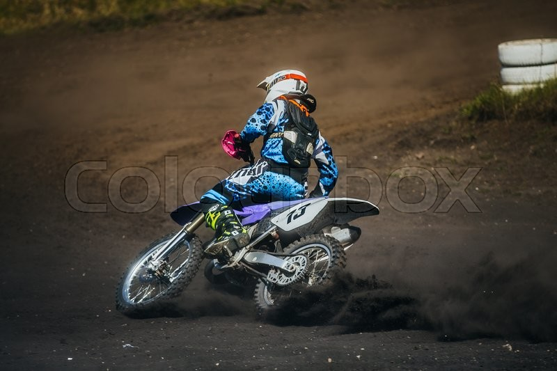 Editorial image of 'Miasskoe, Russia - May 02, 2016: racer on a motorcycle skid on race track during Cup of Urals motocross'