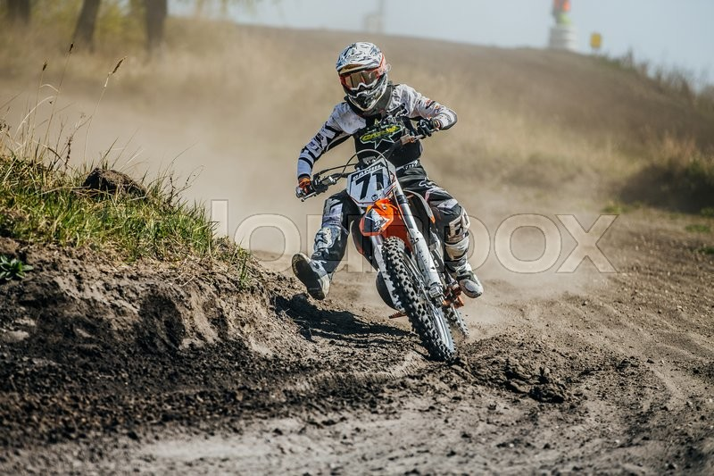 Editorial image of 'Miasskoe, Russia - May 02, 2016: racer on a motorcycle turns on a dusty race track during Cup of Urals motocross'