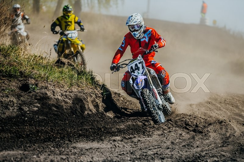 Editorial image of 'Miasskoe, Russia - May 02, 2016: group racer on a motorcycle turns on a dusty race track during Cup of Urals motocross'