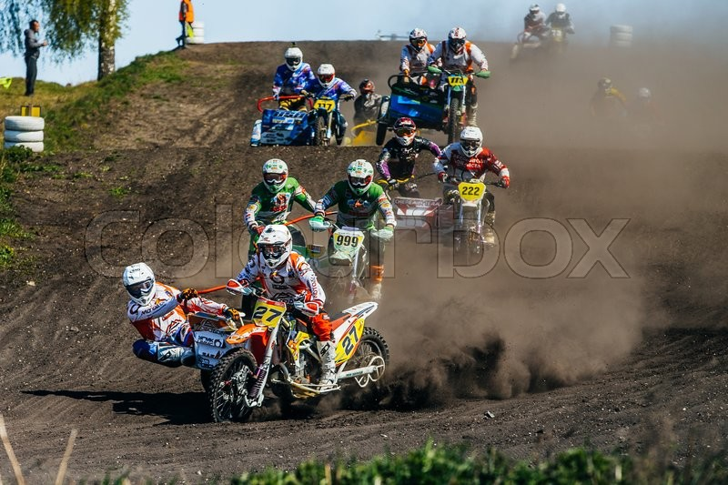 Editorial image of 'Miasskoe, Russia - May 02, 2016: group of motorcyclists with sidecars riding along a dusty track during Cup of Urals motocross'