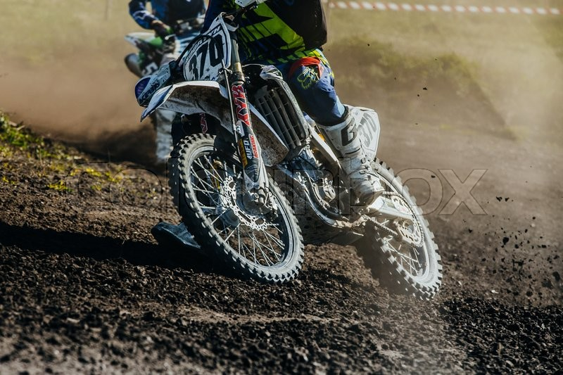 Editorial image of 'Miasskoe, Russia - May 02, 2016: closeup of motorcycle rides on dusty track during Cup of Urals motocross'