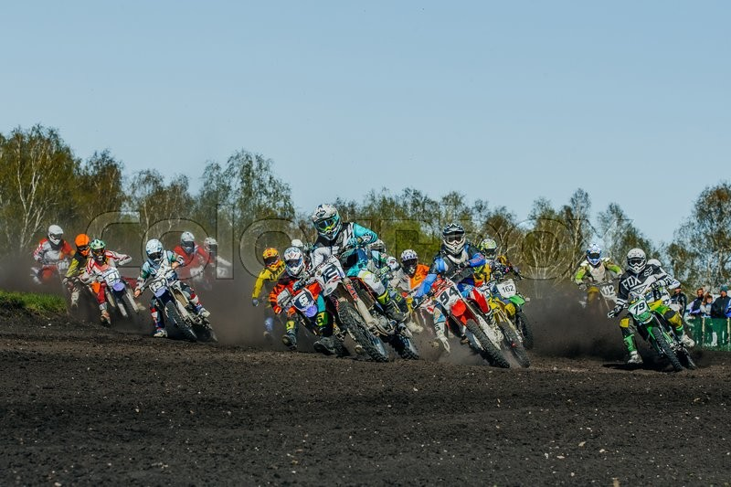 Editorial image of 'Miasskoe, Russia - May 02, 2016: group of riders motorcycle rides on dusty track during Cup of Urals motocross'