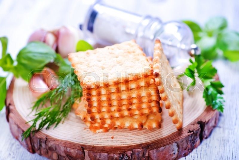 Stock image of 'cracker with garlic and salt on a table'