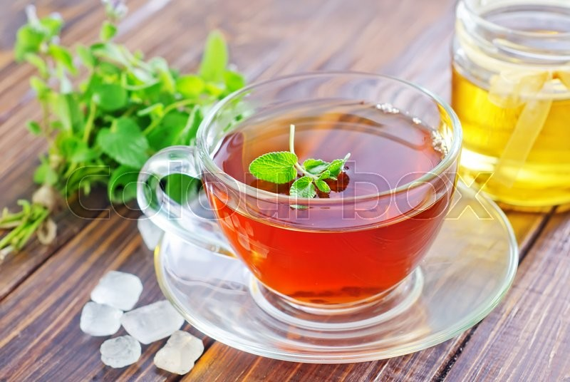 Stock image of 'Tea with mint and honey'