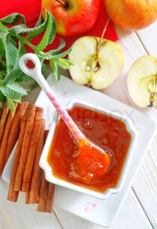 Stock image of 'Jam and apples'