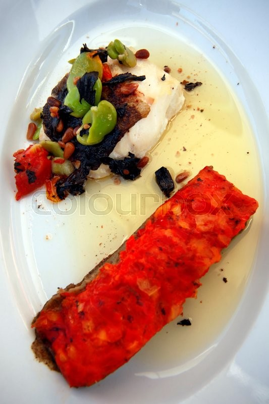 Stock image of 'Fillet of dorado with vegetables and oil'