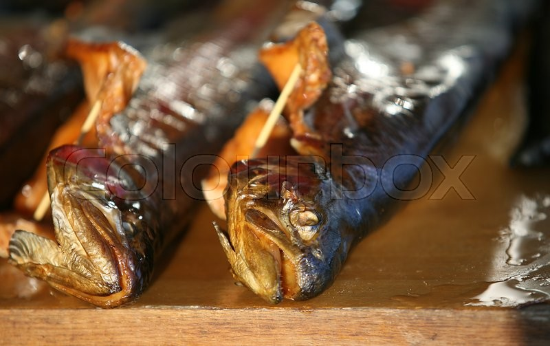 Stock image of 'Smoked trout on a counter'