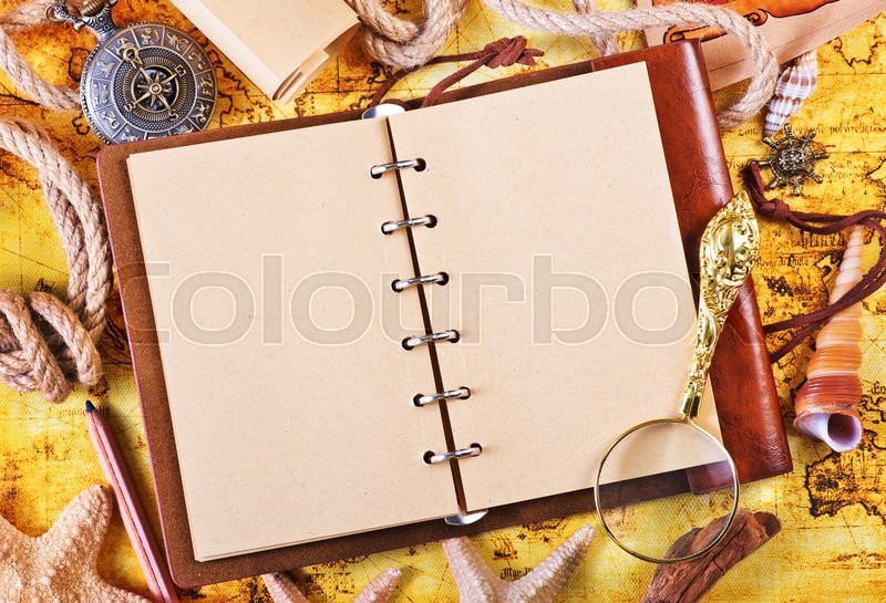 Stock image of 'old notebook, loupe and compass on the map'