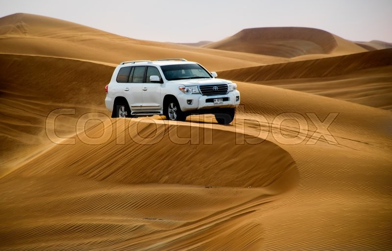 Stock image of 'ABU DHABI, UAE - FEBRUARY 01: Desert safari in Dubai, United Arab Emirates. Dune bashing by a 4x4 car is a very popular activity.'