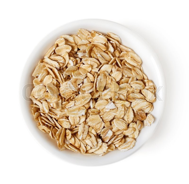 Stock image of 'Bowl of oat flakes isolated on white background, top view'
