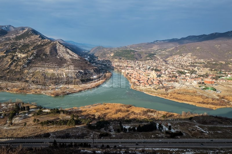Stock image of 'Jvari. Georgia. Panoramic view to the the confluence of the Mtkvari and Aragvi rivers and the town of Mtskheta.'