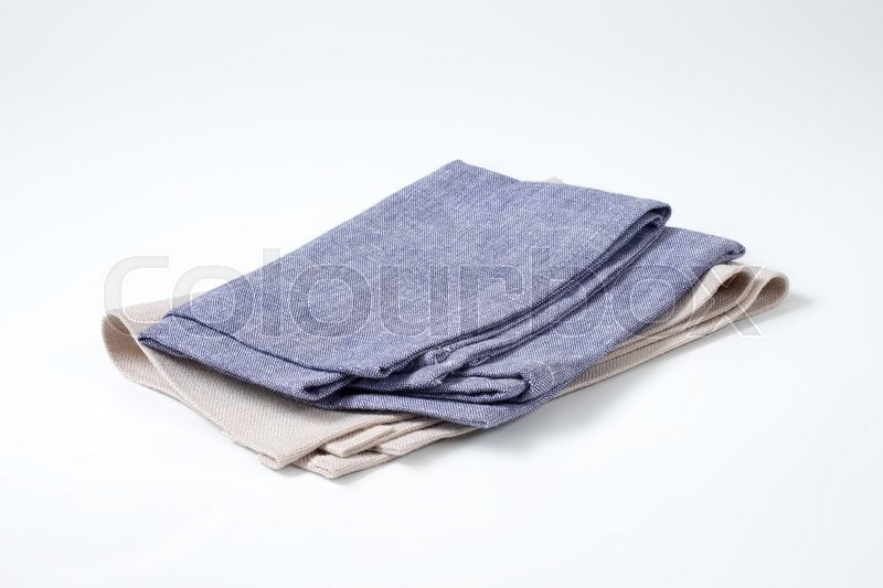 Stock image of 'folded blue and gray napkins'