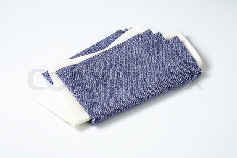 Stock image of 'two folded cloth napkins or place mats'