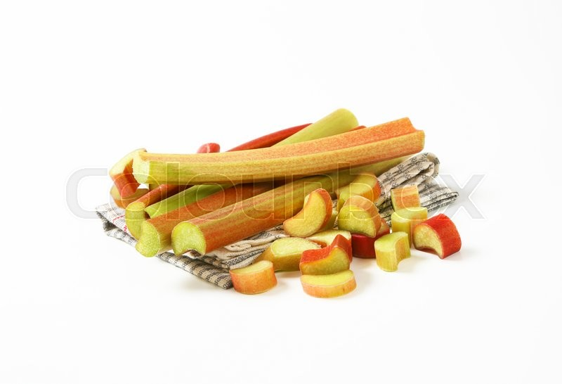 Stock image of 'fresh rhubarb stems on dish towel'
