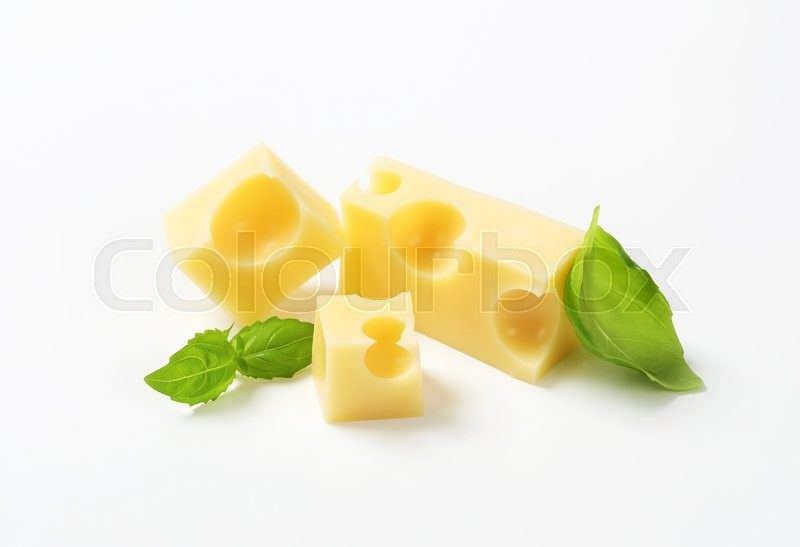 Stock image of 'pieces of emmental cheese on white background'