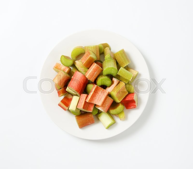 Stock image of 'fresh rhubarb stalks cut into pieces'