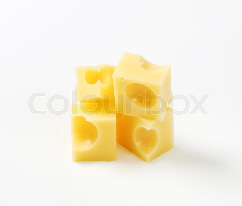 Stock image of 'cubes of fresh emmental cheese on white background'