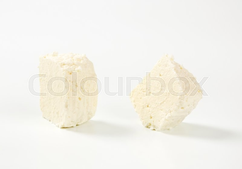 Stock image of 'pieces of fresh curd cheese'