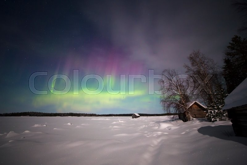 Stock image of 'White sea shore under the lights of Aurora borealis. Northern Karelia. Russia.'