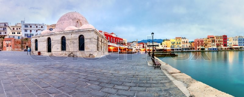 Stock image of 'Picturesque panoramic view of Venetian quay of Chania with Kucuk Hasan Pasha Mosque during cloudy morning blue hour, Crete, Greece'