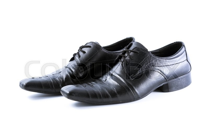 Stock image of 'Used men shoes on white background'