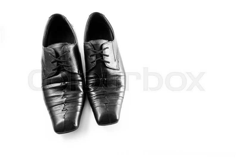 Stock image of 'Old Black Mens shoes on white background'
