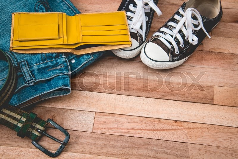 Stock image of 'Vintag jean,cloths and accessories on a wooden background'