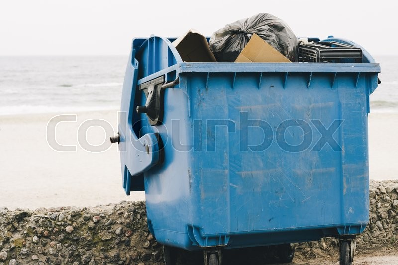 Stock image of 'Blue garbage container on the coast'