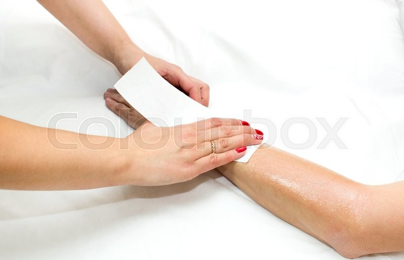 Stock image of 'Woman in a beauty salon doing depilation'
