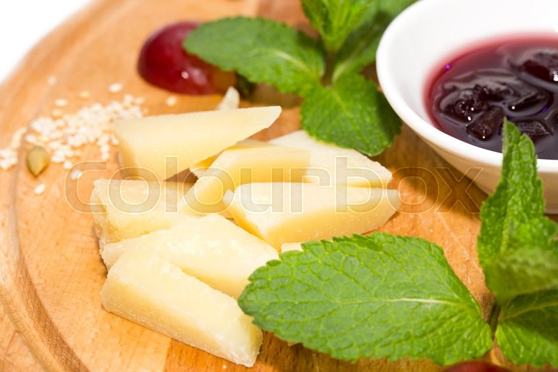 Stock image of 'Cheese plate with a large decorated the assortment of mint'